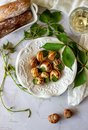 Bourguignonne snail with lemon. Marble background. French cuisine Royalty Free Stock Photo
