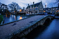 Bourton on the water this is a pretty little village in cotswolds england image was taken at dusk christmas day you can see Stock Image