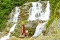 Bouteur dedans en front of beautiful nature scene Image stock