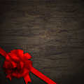 Bow on black wall wood texture red background Stock Images