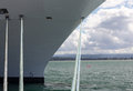 Bow of cruise ship in rotorua nz a docked the harbor with the focus on the bollards and ropes mooring the boat to the harbour wall Stock Photography