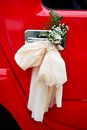 Bow with flowers on door handle of wedding limo Stock Photos