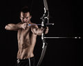 Bow-hunter with a modern compound bow Royalty Free Stock Photo