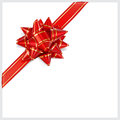 Bow of red ribbon located diagonally with gold stripes with shadow on white background Stock Image