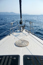 On the bow of a sailing yacht in aegean sea Royalty Free Stock Photography