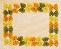 Bow tie pasta border horizontal photo of arranged on light wood background Royalty Free Stock Photo