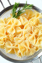 Bow tie pasta in a sieve Royalty Free Stock Photo