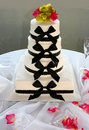 Bow tie wedding cake a with black ties and four layers Royalty Free Stock Image