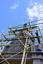 Bower on advancement and bamboo scaffolding Stock Images