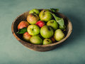 Bowl of apples on green table Royalty Free Stock Photo