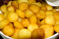 Bowl with baked potatoes Royalty Free Stock Photos