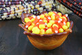 A bowl of candy corn on rustic wooden table Stock Photography