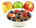 Bowl of cereal with apples Royalty Free Stock Images