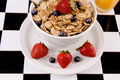 Bowl of cereal with fresh fruit. Royalty Free Stock Photos
