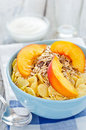 Bowl of cereal with muesli and fresh peach Royalty Free Stock Photography