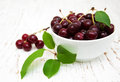 Bowl with cherries on a old wooden background Stock Image