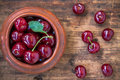 Bowl of cherries on old wooden background rustic Royalty Free Stock Photos