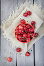 Bowl of cherries an overhead shot a in a rustic setting Royalty Free Stock Photos