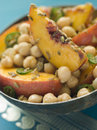 Bowl of Chick Pea and Peach Salad Stock Photography