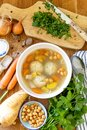 Bowl of chicken soup garnished with parsley Royalty Free Stock Photo