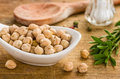 Bowl with chickpeas on a wooden background Royalty Free Stock Photo