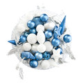 Bowl of christmas blues and whites an overhead view a cut glass full shiny silver leaves blue white bulbs on a white background Stock Image
