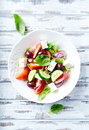 Bowl of colorful summer salad with feta and olives Royalty Free Stock Photo