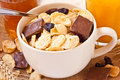 Bowl cornflakes raisins chocolate breakfast Royalty Free Stock Images