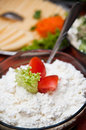 Bowl of cottage cheese white with salad garnish on buffet Stock Image