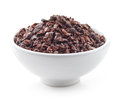 Bowl of crushed cocoa beans on white Royalty Free Stock Photo
