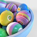 Bowl filled with easter eggs painted different decoration Royalty Free Stock Images
