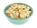 Bowl filled with sliced almonds on a white background Royalty Free Stock Photo