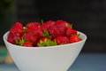 Bowl filled with succulent juicy fresh ripe red strawberries white Royalty Free Stock Image