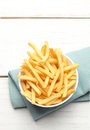 Bowl of french fries on a turquoise napkin Royalty Free Stock Photo