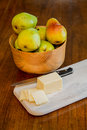 Bowl fresh bartlett pears wood table sliced cheese paring knife wood cutting board Stock Images