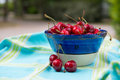 Bowl fresh cherries full outdoor Stock Image