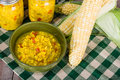 Bowl of fresh corn relish with corn in a green ears Royalty Free Stock Photography