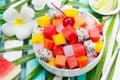 Bowl of fresh exotic fruit salad Healthy breakfast Royalty Free Stock Photo