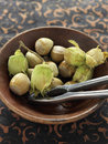 Bowl of fresh hazelnuts and nutcrakers Royalty Free Stock Image