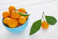 Bowl of fresh mandarins on wooden background Stock Images