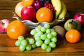 Bowl with fresh, natural looking fruit in close up Royalty Free Stock Photo