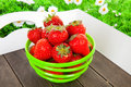 Bowl with fresh strawberries on tray Royalty Free Stock Image