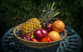 Bowl of fruits healthy in a on a outside table Royalty Free Stock Image