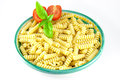 Bowl of fusilli pasta with tomatoes and basil Stock Photo