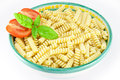 Bowl of fusilli pasta with tomatoes and basil Stock Image