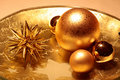 Bowl with golden Christmas decoration Royalty Free Stock Photo