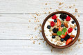 Bowl of greek yogurt with granola, oats, berries and nuts for healthy breakfast Royalty Free Stock Photo