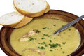 Bowl of Hearty Pea and Ham Soup with Sliced Bread Royalty Free Stock Photo