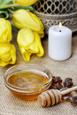 Bowl of honey on wooden table. Symbol of healthy living Royalty Free Stock Photo