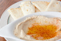 Bowl of hummus with olive oil and pita Stock Photos